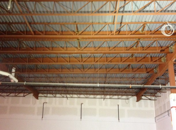 <span>Structural Steel Roof Reinforcing:</span> New Steel Beams installed between exsiting steel joists to reinforce the existing roof structure.
